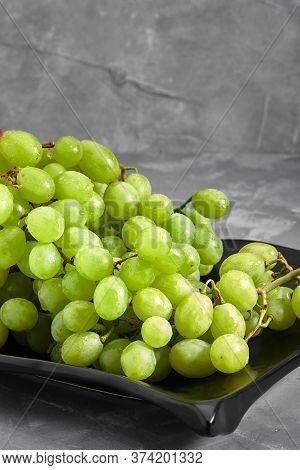 Ripe Sweet White Grapes. Bunch Of Grapes And Grapes On A Concrete Gray Background