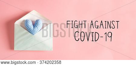 Fight Against Covid-19 Message With A Blue Heart Cushion In An Envelope
