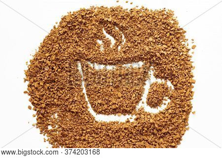 Instant Coffee Sprinkled On A White Background, Texture Of Coffee Granules, Silhouette Of A Coffee C