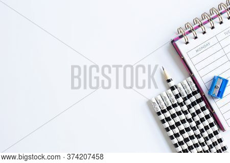 Weekly Organizer Planner, Shaper And Sharp Pencil Surrounded By Dull Pencils. Stationery Flat Lay. B