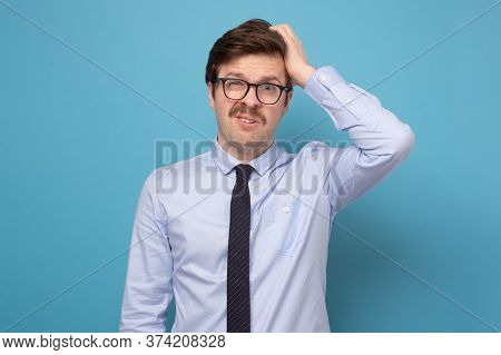 Young Businessman Puzzled Trying To Make A Hard Decision