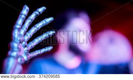 The Hand Of The Skeleton In The Foreground In The Nightclub Blurred Man In The Background