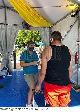 Orlando, Fl/usa - 6/18/20:  A Person Getting Their Temperature Taken Before They Can Enter The Seawo