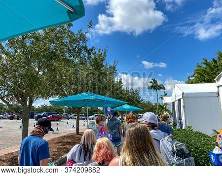 Orlando, Fl/usa - 6/18/20:  People Waiting In Line To Get Temperature Checks Before They Can Enter T