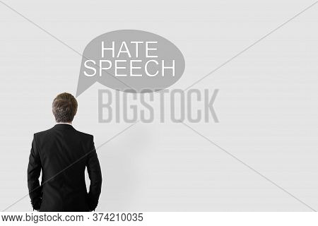 Hate Speech Concept. A Man With His Back To The Camera And A Cloud Of Thoughts With The Words Hate S