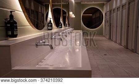 Townsville, Queensland, Australia - June 2020: Inside Public Rest Room Bathroom At A Luxury Resort H