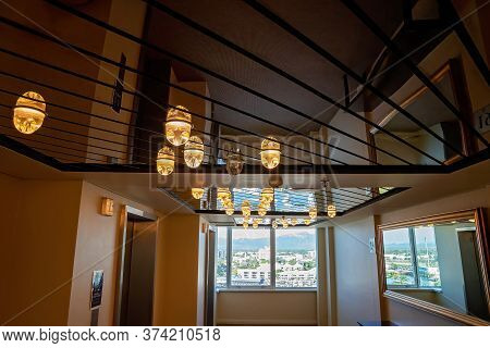 Townsville, Queensland, Australia - June 2020: Ceiling Lights Outside A Lift With A City View Beyond
