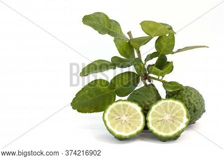 Whole And Cut Half Bergamot, Kaffir Lime, Leech Lime Or Mauritius Papeda With Leaf Is A Vegetable An
