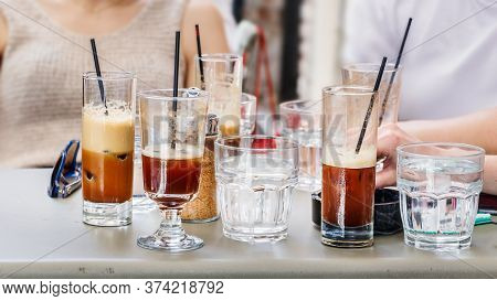 Glasses With Greek Frappe Cold Coffee With Straw On A Table Outdoors A Coffee Shop.