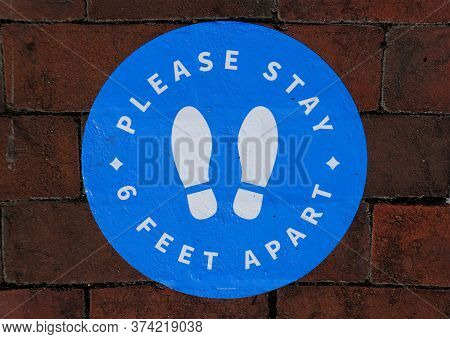 Williamsburg, Virginia, U.s.a - June 30, 2020 - The Sticker On The Brick Walkway Asking The Customer