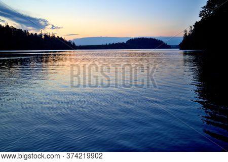 Sunrise On Slezská Harta, Calm Water Surface, Morning Reflections