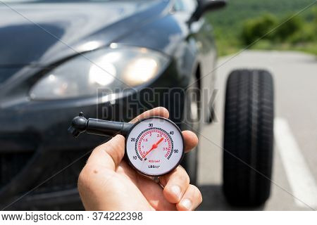 Picture Of Black Car\'s Brand New Tyre On The Road On A Summer Day