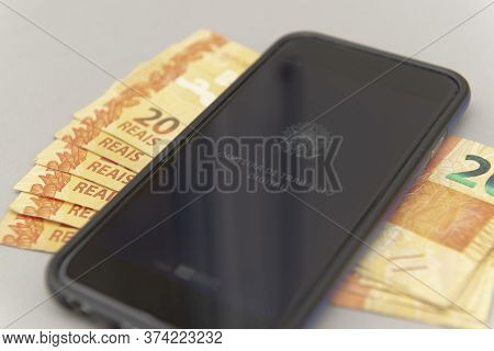 June 27, 2020, Brazil: Close Up Of Cellphone And Real Banknotes - Brazilian Work Document And Social