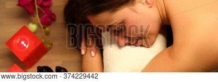 Woman Likes Spa Treatments In Salon, Near Candles. Woman Feels Tired And Needs To Be Restored. To Tu