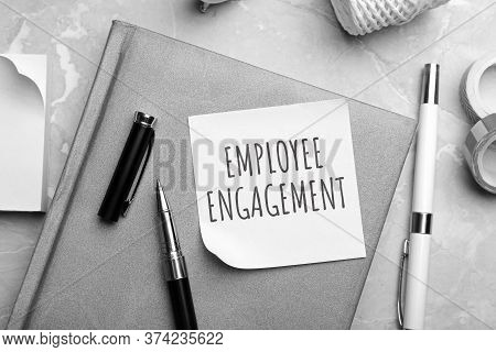 Note With Text Employee Engagement And Stationery On Table, Flat Lay