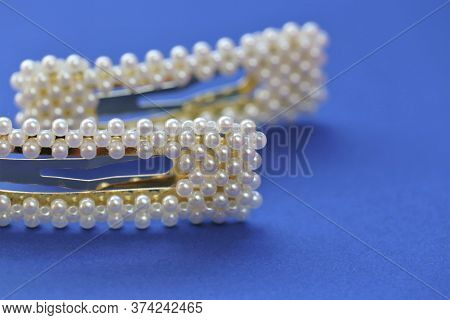 Pearl Hair Clips Set On A Blue Background. Fashionable Hair Accessories. Hairpin With Pearls.differe