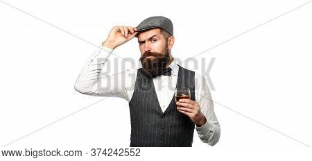 Stylish Rich Man Holding A Glass Of Old Whisky. Bearded Gentleman Drink Cognac. Sipping Finest Whisk