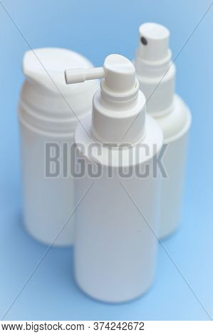 Plastic White Bottles Mockup. Cosmetic Bottles Set On A Blue Background. Beauty And Health Tools Con