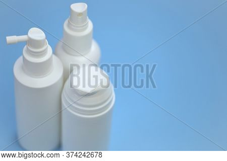 Plastic White Bottles Mockup. Cosmetic Bottles Set On A Light Blue Background. Beauty And Health Con