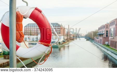 Lifebuoy On The City Embankment. Coast Security. For News Of Banner.