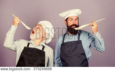 Eat Concept. Culinary Dynasty. Mature Bearded Men Professional Restaurant Cooks. Teaching Culinary.