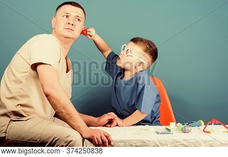 Kid Little Doctor Sit Table Medical Tools. Illness Treatment. Dad And Son Medical Dynasty. Medical E