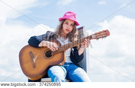 Free Music Content. Teenage Musician Playing Guitar. Portrait Of Little Kid Playing Guitar On Sky Ba