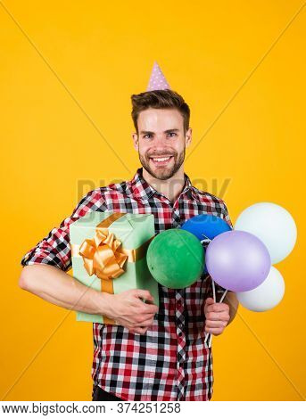 Handsome Cheerful Young Man With Smile Having Fun On Party. People And Joy. Birthday And Celebration