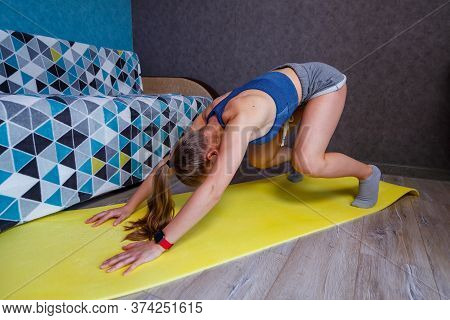 Young Woman Practicing Yoga, Standing In Dog Pose Face Down, Exercises Adho Mukha Svanasana, Girl In