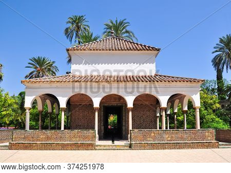 Pavilion In Seville Alcazar Gardens In Summer, Spain