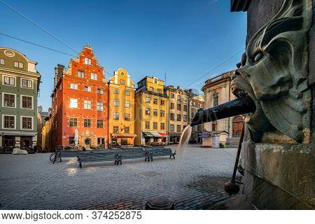 Stockholm, Sweden - June 28, 2020:Colourful building  in  Old Town early morning in Stockholm, Sweden