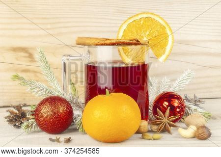 Mulled Wine In A Glass With A Set For Mulled Wine On A Wooden Background.