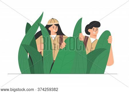 Explorers, Travelers In The Jungle Large Green Leaves. Man And Woman Enjoy A Picturesque Landscape O