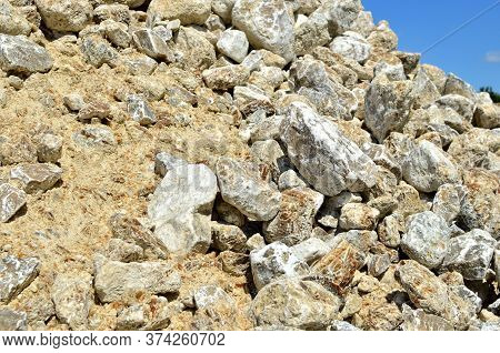 Natural Gray Gypsum Stone. Close Up Image Of Stones With Black And White. Industrial Mining Area. Li