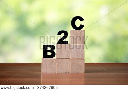 Wooden Cube Block Shapes As Step Stairs With B2c Business To Consumer Word. Business Concept, Succes