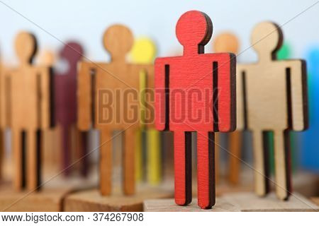 Close-up Of Bright Red Colour Wooden Figure Standing On Square Blocks. Leadership And Creativity. Gr