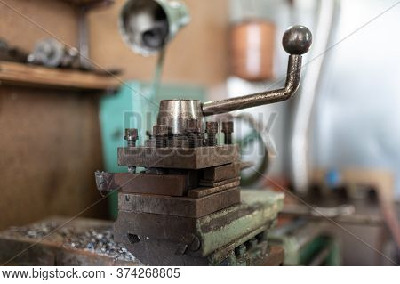 A Part Of The Old Lathe Machine Is Painted Green. A Small Workshop For Metal Processing. Screw Turni