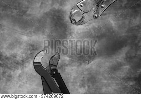 Creative Image Of Plumbing Wrenches As Birds On Gray Background. Black And White Unusual Bird Story.