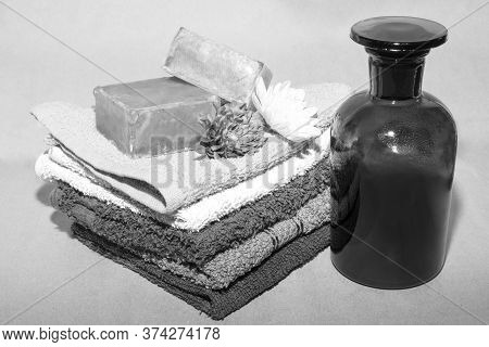 Soap Bar On Top Of Facecloths Off Various Shades With Flowers And Bottle
