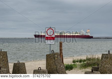 Lng Terminal And Tanker - Fence And No Entry Sign On The Seaport