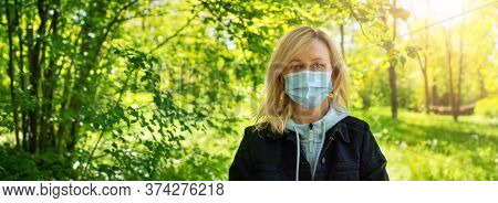 Young Woman In Medical Face Protection Mask Outdoors In Nature