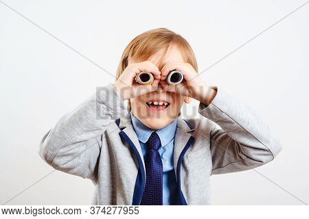 Cute Child Using Money As Binoculars. Happy Little Businessman On White Background. Child With Binoc