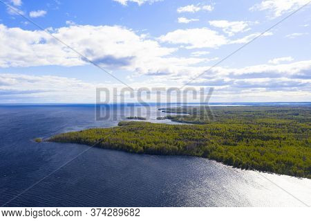 Aerial View Summer Forest And Lake. Top View. Coastline View From Drone. Aerial Top View Cloudscape.