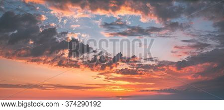 Dramatic Sunset Sunrise Sky With Blue, Orange And Yellow Colors. Panorama Evening Or Morning Sky