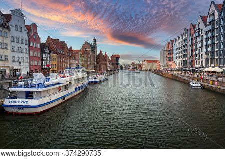 Gdansk, Poland - June 20, 2020: Architecture of the old town in Gdansk over Motlawa river, Poland. Gdansk is the historical capital of Polish Pomerania with medieval old town architecture.
