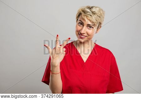 Portrait Of Young Attractive Female Nurse Showing Number Three