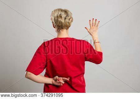 Back View Of Young Attractive Female Nurse Showing Fake Oath