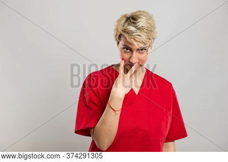 Portrait Of Young Attractive Female Nurse Making Look Into My Eyes