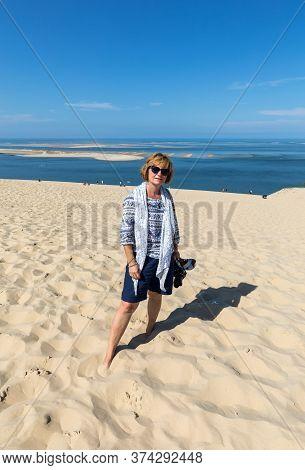 Dune Of Pilat, France - September 10,2018: Woman On The Dune Of Pilat, The Tallest Sand Dune In Euro