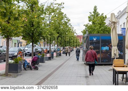 Cluj-napoca , Romania  - May 28 2020: People Walking On Cluj City Center Streets.